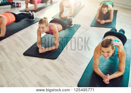 Fit Young Women Doing Exercise On Abs