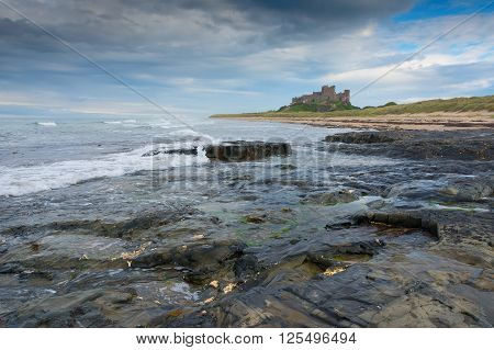 Bamburgh castle viewed from a distance at dusk along the coast England