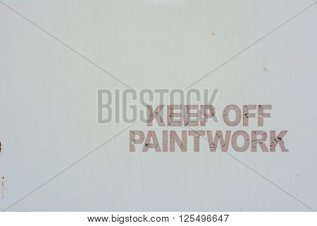 Keep Off Paintwork hand painted sign against a plain white metal background