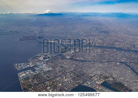 Aerial view of Tokyo Bay and Mount Fuji in Tokyo, Japan.