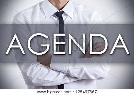 Agenda - Young Businessman With Text - Business Concept