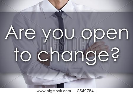 Are You Open To Change? - Young Businessman With Text - Business Concept