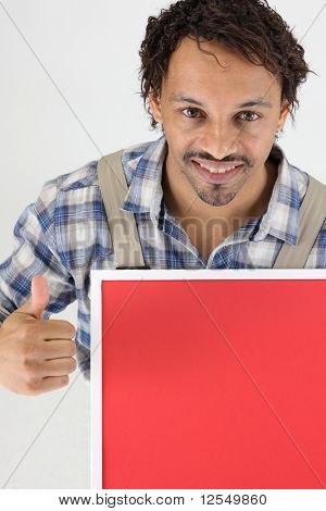 Workman holding a red panel for message