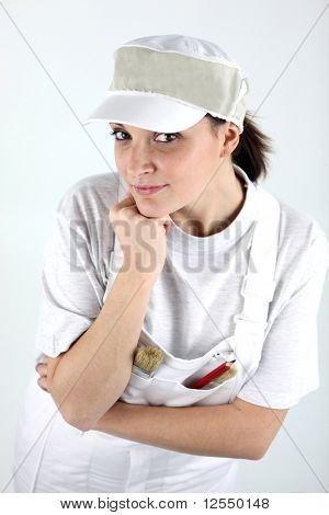 Portrait of a young painter on white background
