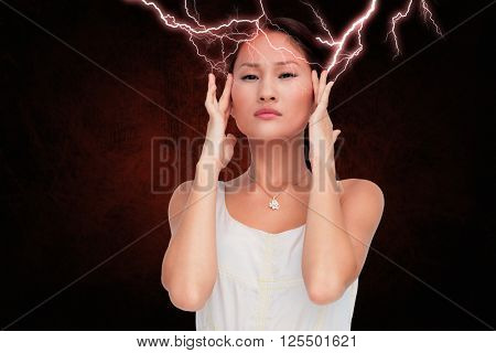 Concerned woman posing and looking at camera against dark background