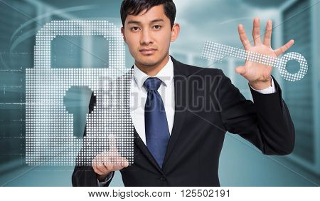 Unsmiling businessman holding and pointing against composite image of server towers