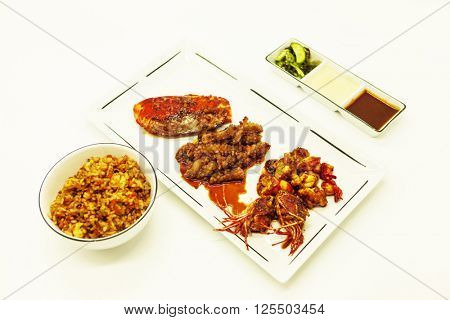 Fried tiger prawns and octopus in a Chinese style grilled barbecue in a spicy oil with fried rice and sauces