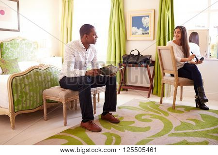 Young multi ethnic couple in hotel room prepare for the day