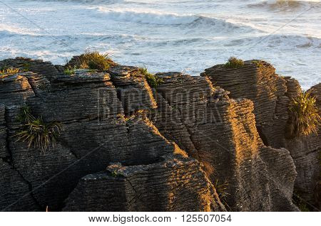 Pancake Rocks in Paparoa National Park New Zealand. Seascape with layered rock formation. Punakaki layered rock formation is famous tourist destination for South Island New Zealand