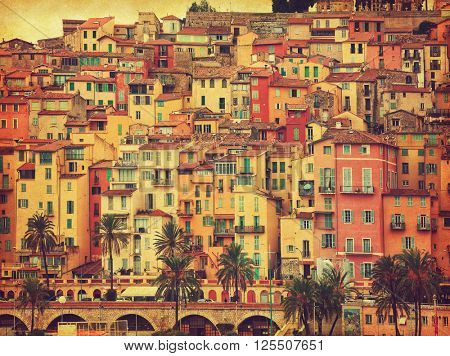 Colorful houses in old part of Menton, France.  Added paper texture. Toned image