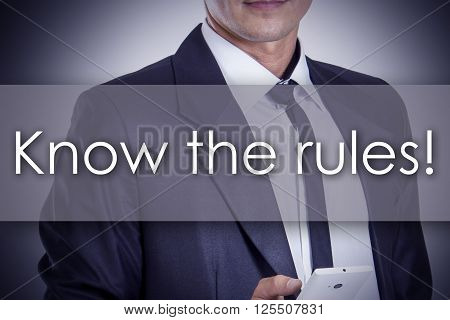 Know The Rules! - Young Businessman With Text - Business Concept