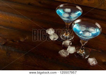 Blue cocktail with ice copy space. Blue Martini. Blue Hawaiian cocktail. Blue curacao liqueur. Blue margarita