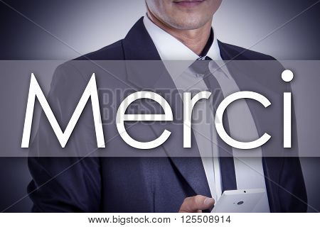Merci - Young Businessman With Text - Business Concept