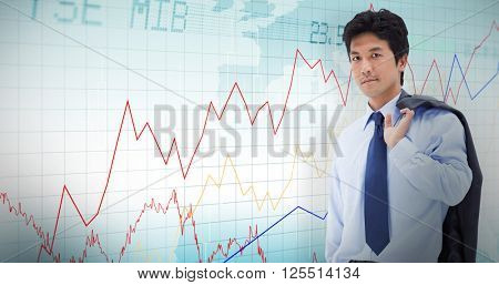 Portrait of a businessman holding a briefcase and his jacket on his shoulder against stocks and shares