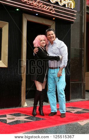 LOS ANGELES - APR 11:  Cyndi Lauper, husband at the Harvey Fierstein and Cyndi Lauper Hollywood Walk of Fame Ceremony at the Pantages Theater on April 11, 2016 in Los Angeles, CA