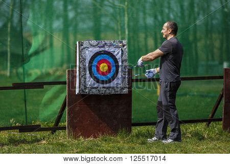 man preparing a bow and arrow shooting range in them