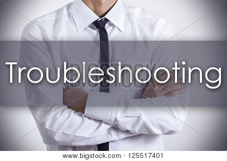 Troubleshooting - Young Businessman With Text - Business Concept