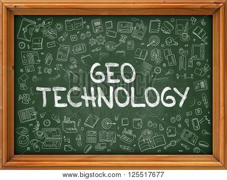 Geo Technology - Handwritten Inscription on Green Chalkboard with Doodle Icons Around. Modern Style with Doodle Design Icons. Geo Technology on Background of  Green Chalkboard with Wood Border.