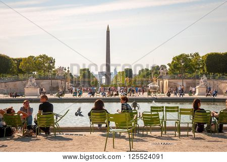 People Relaxing In Garden Of Tuileries