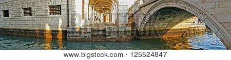 VENICE ITALY - JANUARY 24 2016: Panoramic view of the historical buildings on a canal in Venice Italy.