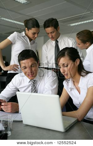 Young business people meeting with laptop computer and documents