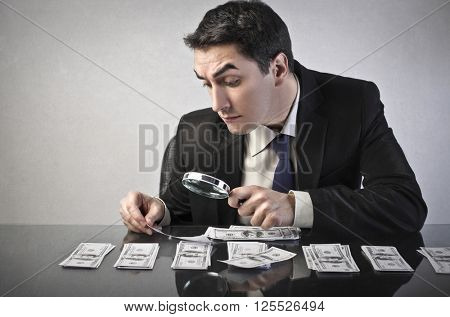 Businessman inspecting banknotes