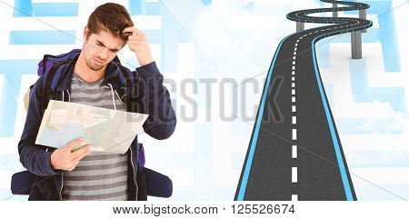Man scratching head looking in map against blue background