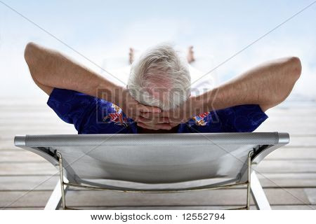 Senior man relaxing in a deck chair