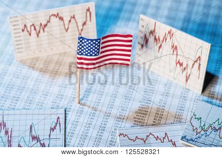 American flag with rate tables and graphs for economic development.