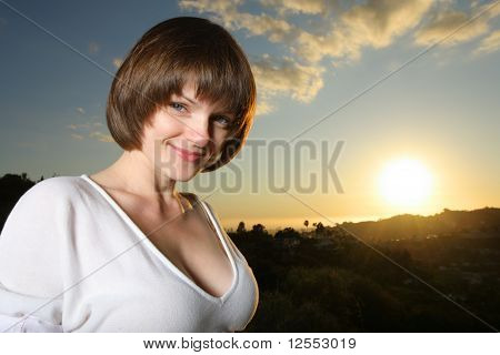 Portrait Of A Beautiful Young Woman At Sunset