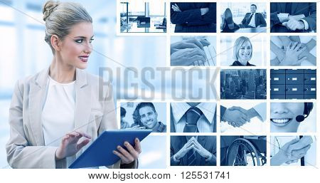 Cheerful stylish businesswoman using digital tablet against composite image of shaking hands over eye glasses and diary after business meeting