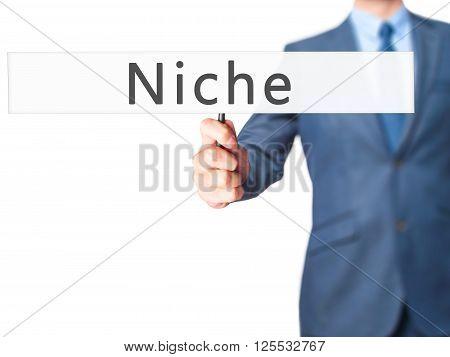 Niche - Businessman Hand Holding Sign