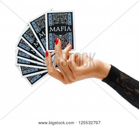 Women's Hand holding playing cards isolated on white background. Game concept