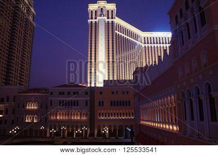 MACAU, MACAU S.A.R. - NOVEMBER 23: The night facade of Venetian casino resort and luxury hotels in Macau Peninsula on 23th of November, 2015 in Macau.