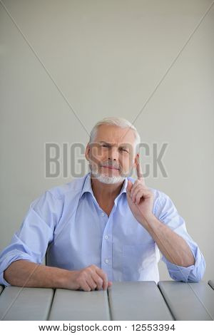 Portrait of a senior man suspicious