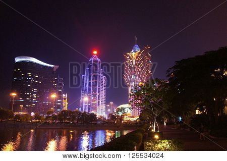 MACAU, MACAU S.A.R. - NOVEMBER 23: The night facades of Grand Lisboa Macau casino resort and Wynn luxury hotels in Macau Peninsula on 23th of November, 2015 in Macau.
