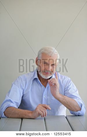 Portrait of a senior man threatening