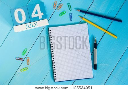 July 4th. Image of july 4 wooden color calendar on blue background. Summer day. Empty space for text. Independence Day Of America.