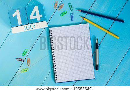July 14th. Image of july 14 wooden color calendar on blue background. Summer day. Empty space for text. Storming of the Bastille Day.