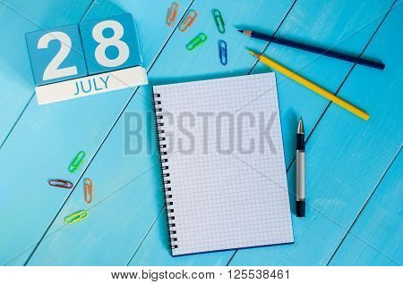 July 28th. Image of july 28 wooden color calendar on blue background. Summer day. Empty space for text. World Hepatitis Day.