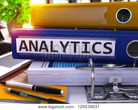 Analytics - Blue Ring Binder on Office Desktop with Office Supplies and Modern Laptop. Analytics Business Concept on Blurred Background. Analytics - Toned Illustration. 3D Render.