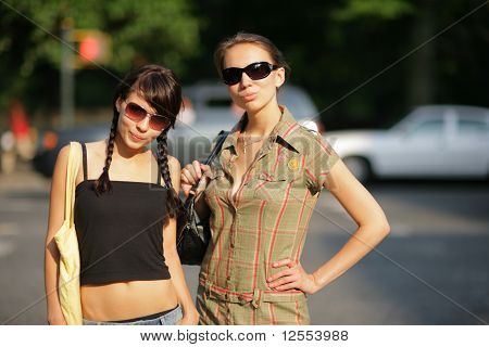Two Beautiful Girls In Sunglasses