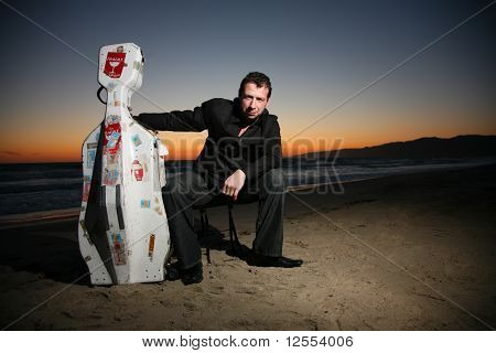 Musician With Travel Cello Case.