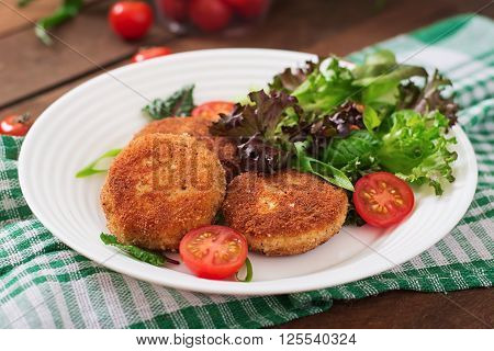 Small Chicken Cutlet With Vegetables On A Plate