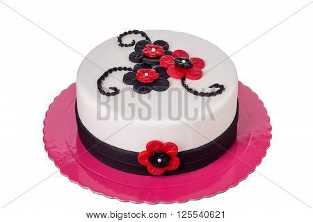 Birthday cake from sugar pastes red flowers. On birthday.