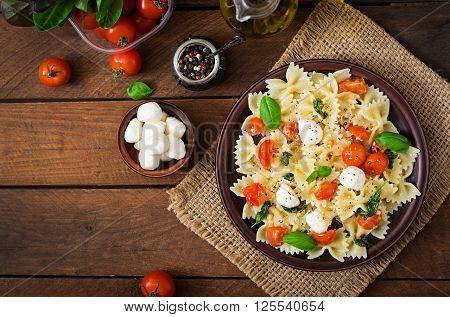Farfalle Pasta - Caprese Salad With Tomato, Mozzarella And Basil. Top View