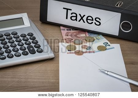 Taxes Written On A Binder