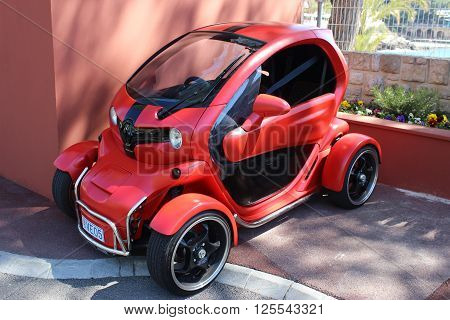Monte-Carlo Monaco - April 11 2016: Red and Black Electric Car Renault Twizy (Tuning) Parked in a Parking Lot of Monte-Carlo Beach Club in Monaco