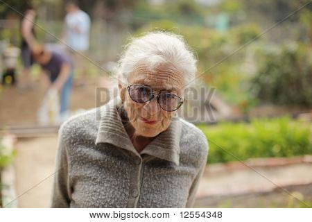 Portrait Of A Senior Woman Outdoors, Looking In Camera