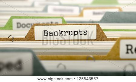 File Folder Labeled as Bankrupts in Multicolor Archive. Closeup View. Blurred Image. 3D Render.